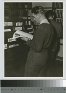 Student reading a magazine, Library, Eastman Building, Rochester Athenaeum and Mechanics Institute