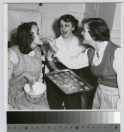 Student activities, three sorority sisters cooking in a dormitory kitchen at Rochester Institute of Technology, Downtown Campus.