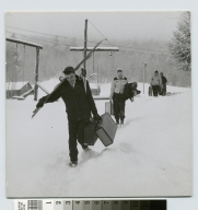 Student activities, members of the Rochester Institute of Technology ski club walking through the snow, 1951