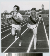 Student activities, two members of the Rochester Institute of Technology's men's track team crossing the finish line during a meet, 1969