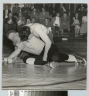 Student activities, Rochester Institute of Technology wrestling match between an Rochester Institute of Technology wrestler and an unidentified opponent, [1952]