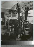 Academics, chemistry, three male Rochester Institute of Technology students working with industrial chemical equipment, [1945-1960]