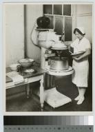 Student preparing food, Rochester Athenaeum and Mechanics Institute [1925-1930]