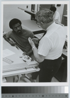 Student and teacher discuss mechanical drawing, National Technical Institute for the Deaf [1970-1971]
