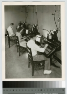 Students operating monotype machines, Department of Publishing and Printing, Rochester Institute of Technology