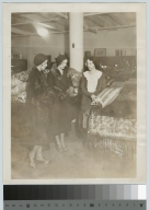 Co-op student and customers at E. W. Edwards department store, Retail Distributing Course, Rochester Athenaeum and Mechanics Institute