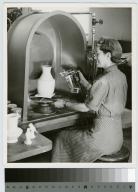 Student firing pottery, School for American Craftsmen, Rochester Institute of Technology