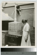 Student working on dehydrating experiment, Rochester Athenaeum and Mechanics Institute