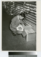 Student counting stock for retail co-op, Retailing Department, Rochester Institute of Technology