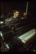 Student at a printing press, Rochester Institute of Technology, Department of Printing, 1971