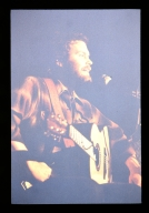 Unidentified guitarist singing