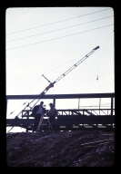 Two workers surveying at construction site