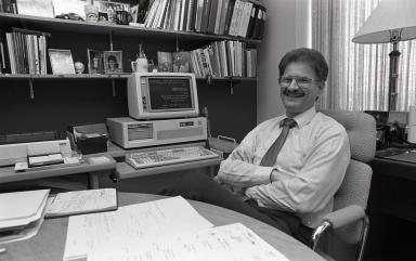 Hurwitz sitting at desk