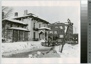 Winter scene, view of Spring Street and Rochester Institute of Technology buildings.
