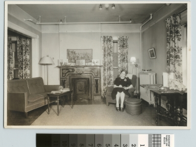 Student in reception room, Jenkinson Apartments, Rochester Athenaeum and Mechanics Institute