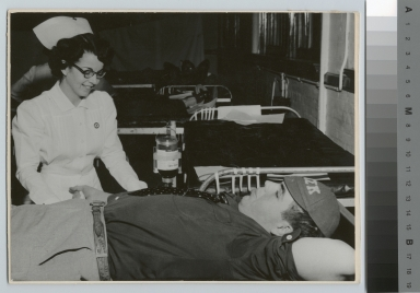Fraternity brother donating blood, Rochester Institute of Technology