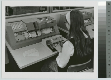 Unidentified student learns keypunch machine operation, Department of Computer Science, Rochester Institute of Technology