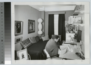 Student activities, male student in a dorm room at Nathaniel Rochester Hall