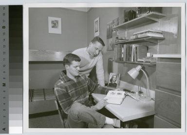Student activities, two male students in a dorm room at Nathaniel Rochester Hall ca. 1960