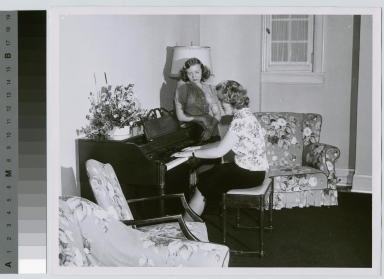 Student activities, two female students at a piano in the lounge of a dormitory at Rochester Institute of Technology [1945-1960]