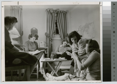 Student activities, female students socializing in a dorm room at Rochester Institute of Technology. Downtown Campus