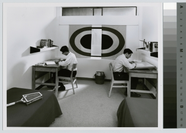Student activities, two male students studying in a dorm room at Rochester Institute of Technology Henrietta Campus