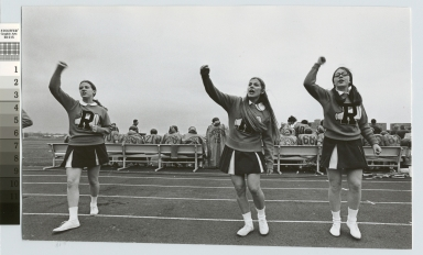 Student activities, cheerleaders at a RIT football game