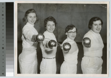 Student activities, four female members of the RIT women's fencing team posing with their epees, March 9, 1956