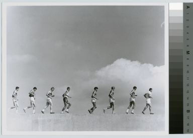 Student activities, Rochester Institute of Technology champion cross-country team running on a wall with coach Peter Todd, 1969