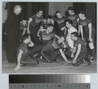 Student activities, members of the Rochester Institute of Technology wrestling team with coach Earl Fuller, and Sherman Hagberg, Director of Athletics, 1952