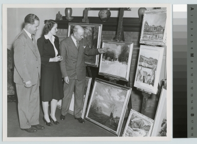 Clifford Ulp, art professor, RIT President Mark Ellingson and commencement speaker Ruth Leach view Ulp's paintings, May 12, 1944