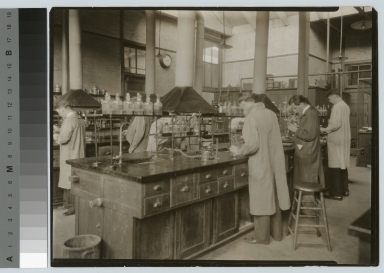 Academics, chemistry, Rochester Athenaeum and Mechanics Institute chemistry laboratory in the Eastman Building with male students working on experiments, [1920-1930]