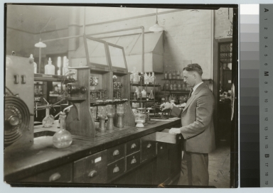 Academics, chemistry, Instructor Ralph Braden working on an experiment in a Rochester Athenaeum and Mechanics Institute chemistry laboratory, [1926-1927]