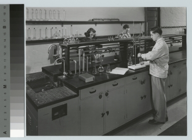 Academics, chemistry, three Rochester Institute of Technology students working on experiments in a chemistry lab, [1945-1955]