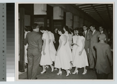 Unidentified students arriving for convocation, Rochester Institute of Technology, Eastman Theatre