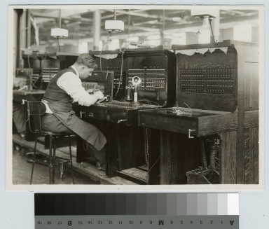 Student wires switchboards, Rochester Athenaeum and Mechanics Institute, Stromberg Carlson Company, [1920-1929]