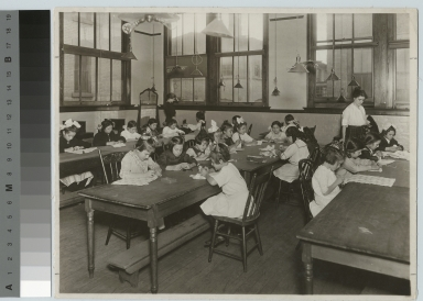 Students teaching sewing class for girls, Department of Household Arts and Science, Rochester Athenaeum and Mechanics Institute [1913]