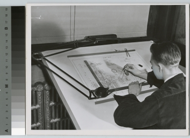 Unidentified student engaged in mechanical drawing, School of Industrial Arts, Rochester Athenaeum and Mechanics Institute [1920-1930]