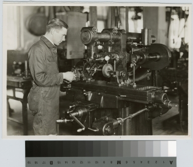 Unidentified student at milling machine, School of Industrial Arts, Rochester Athenaeum and Mechanics Institute [1926]