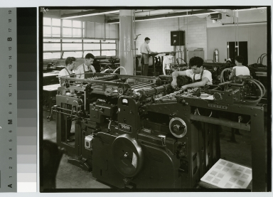 Instructors and students with printing machinery, Department of Publishing and Printing, Clark Building, Rochester Institute of Technology