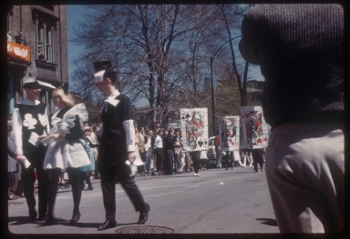 "Spring Weekend parade participants dressed in the theme ""Storybookland,"" Rochester Institute of Technology, 1959"