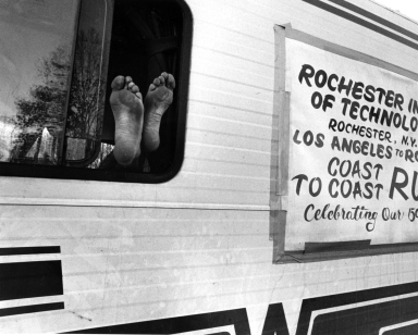 Close-up of a Runner's Feet and the RV for RIT's 150th Anniversary Coast to Coast Run