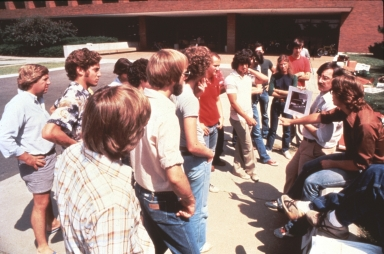 Students gather around professor for Class Outside