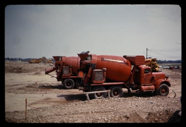 Cement mixer trucks at construction site