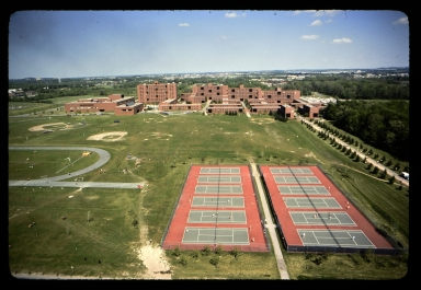 Aerial view of tennis courts and dorms