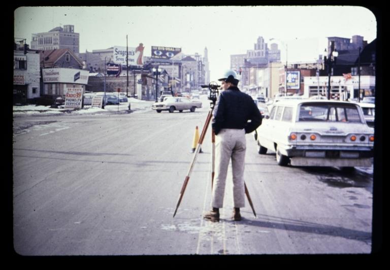 Surveyor in street