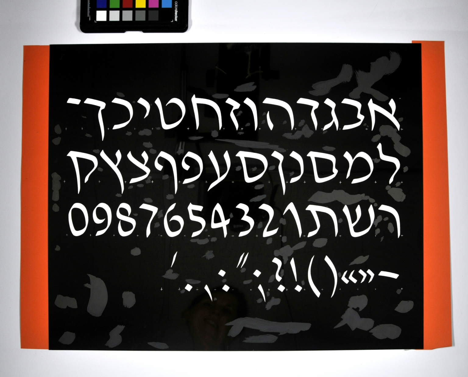 Redrawings of the David Hebrew typeface for dry transfer lettering: italic style, light weight.