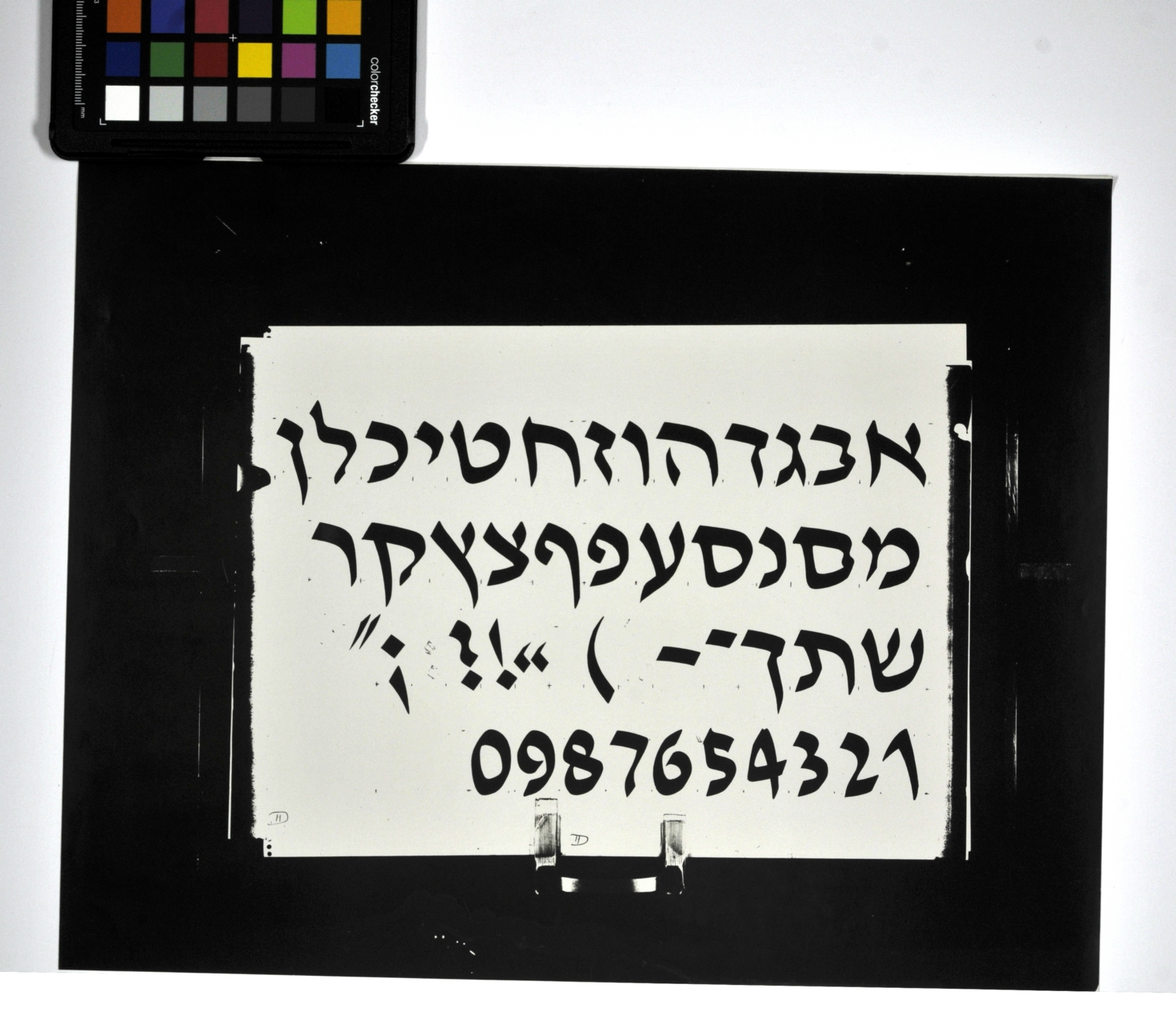 Redrawings of the David Hebrew typeface for dry transfer lettering: italic style, bold weight.