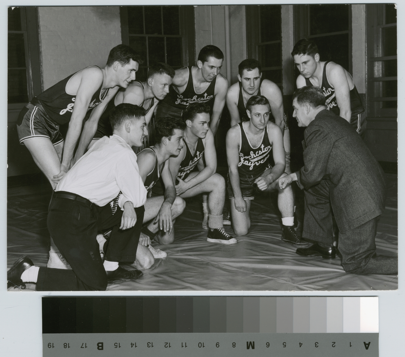 Student activities, group portrait of the Rochester Institute of Technology jayvees basketball team with coach Leo Fox