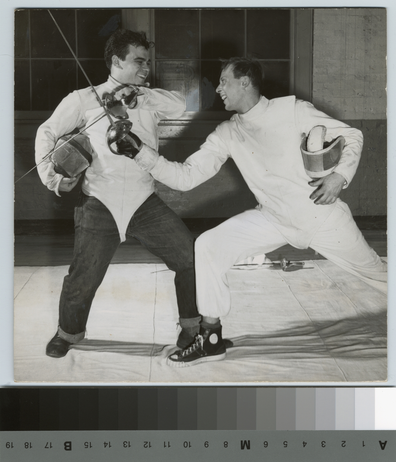 Student activities, two male members of the Rochester Institute of Technology fencing team in a mock engagement with Sabers, 1951
